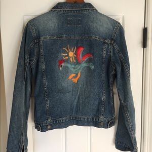 Jean jacket with a rooster stitched on the back